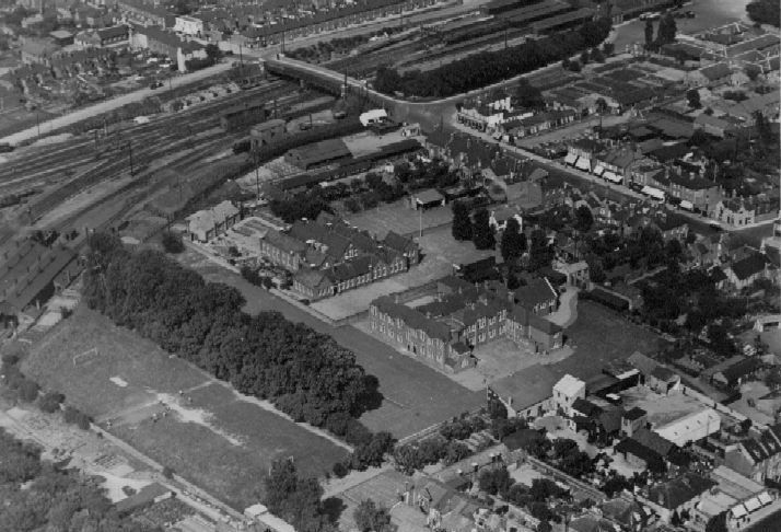 Aerial view of Slough Secondary School buildings - looking north-east - Slough railway station is at top right
